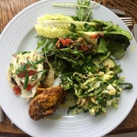 Green salad, cabbage salad, Indian chicken drumsticks and black bean tostadas.